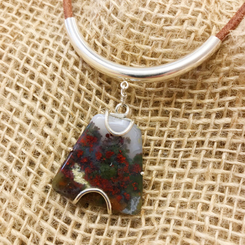 "Moss Agate approximately 1"" x 1"" - Green and Red Colors - Sterling Silver Frame - Sterling Silver Tube Slide Hanger - 4mm Natural Leather approximately 20"" -  Pendant entirely hand-crafted by TKP Craftsman Jay Phinney"