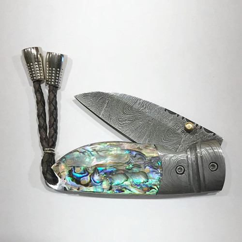 "LUXURY KNIFE QGKN4910 features: 6.0"" Long (open), Damascus Blade (over 250 layers), Rockwell hardness of 56-60 H.R.C., Brass Stud Assist Open, Abalone Shell Handles, Damascus Steel Bolsters"