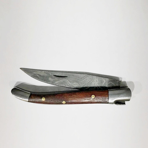 "LUXURY KNIFE QGKN72333 features: 6.5"" Long (open), Damascus Blade (over 250 layers), Rockwell hardness of 56-60 H.R.C., Thumbnail Assist Open, Walnut Wood Handles, Steel Bolsters"