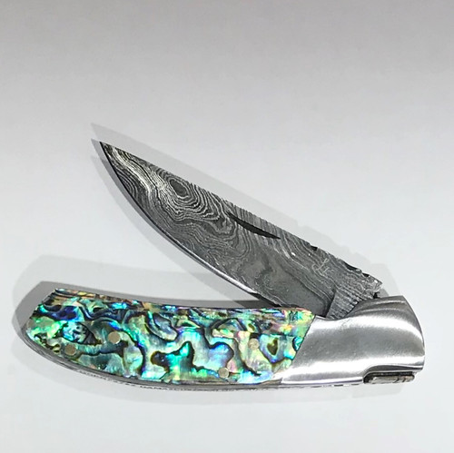 "LUXURY KNIFE QGKN72722 features: 6.5"" Long (open), Damascus Blade (over 250 layers), Rockwell hardness of 56-60 H.R.C., Thumbnail Assist Open, Abalone Shell Handles, Steel Bolsters"