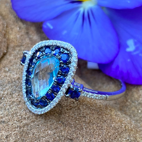 BLUE TOPAZ, SAPPHIRE, AND DIAMOND HALO RING