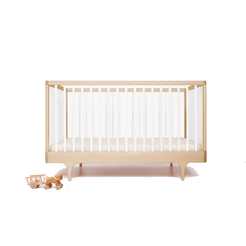 Solid maple crib that plays with classic form and contemporary, ultra-bold colors. Designed with longevity and flexibility in mind, the crib converts as is to a platform-style toddler bed that can be used as seating well beyond the nursery years.