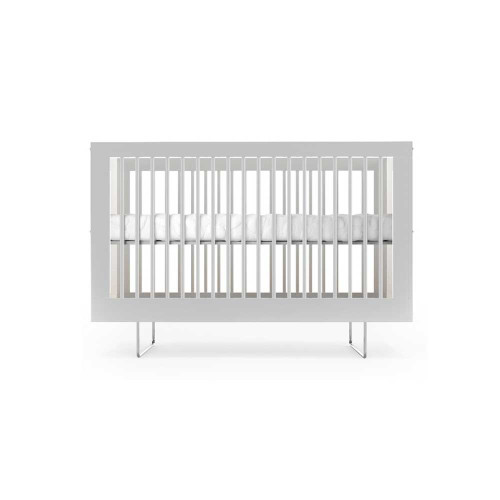 Influenced by mixed material usage within modern architecture, the Alto Crib features airy translucent panels with encapsulated organic materials to create a visually stunning piece for the modern nursery.