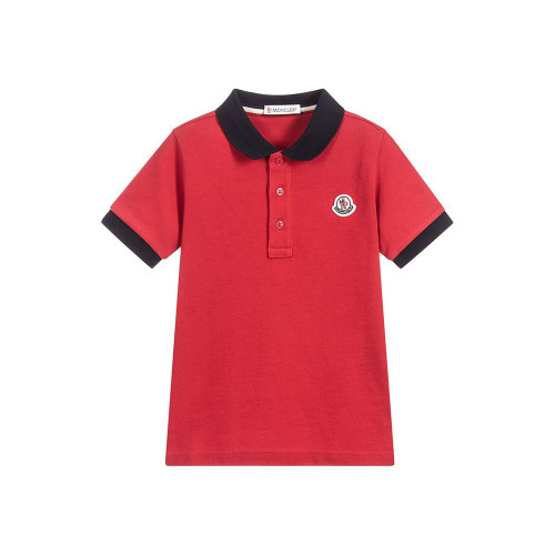 This classic style polo shirt by Moncler is in deep red with navy blue ribbed trims. It is made in cotton piqué with the designer's logo badge on the chest and has button fastenings.