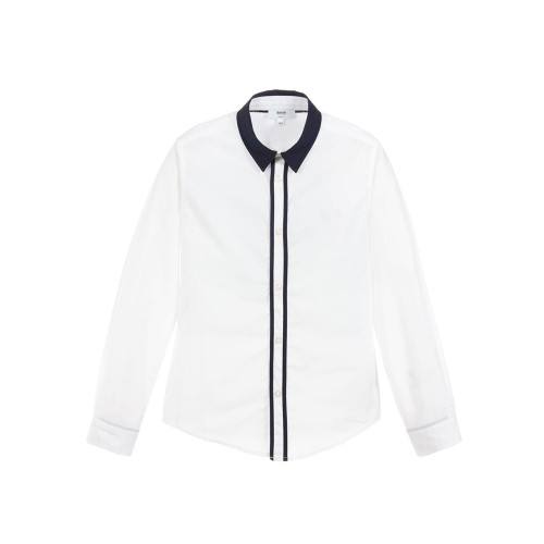 Boys white Mini-me shirt by BOSS, made in lightweight cotton poplin. It has a navy blue collar and navy blue trim down the front placket.