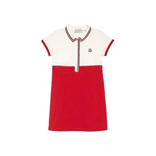 Color-blocked styling accented with a trio of slim stripes distinguishes a sporty polo dress fashioned from cotton stretch piqué.
