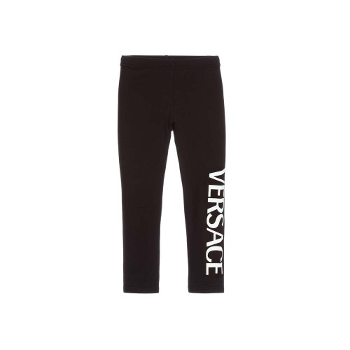 Black logo trousers from YOUNG VERSACE featuring an elasticated waistband and a contrasting brand logo to the bottom of the left leg.