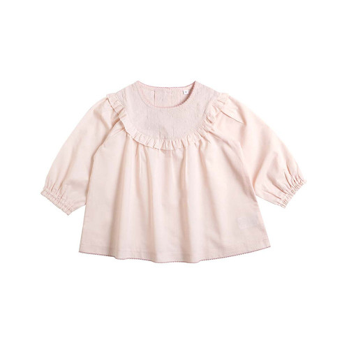 A romantic blouse with plenty of frills and lace.