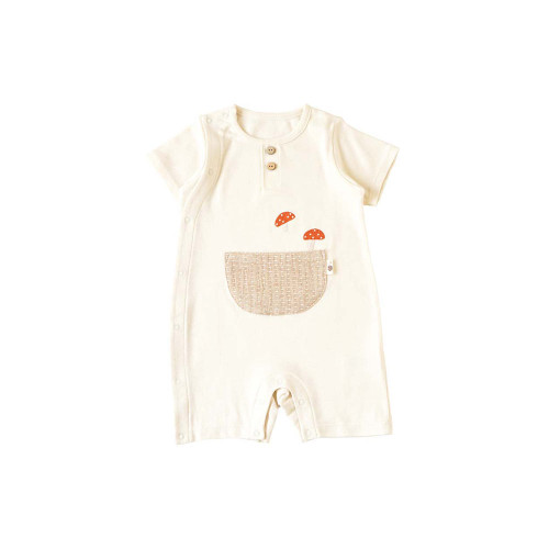 Rompers with mushroom embroidery on soft organic cotton fabric that can be seen from pockets.