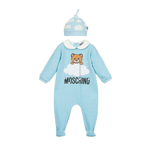 A lovely gift for boys and girls, a pale blue cotton babysuit and hat set by Moschino Baby. It is printed with the brand's Moschino Teddy Bear logo and flocked cloud motif. This soft jersey outfit has a small white collar and jersey lined hat, with matching clouds print.