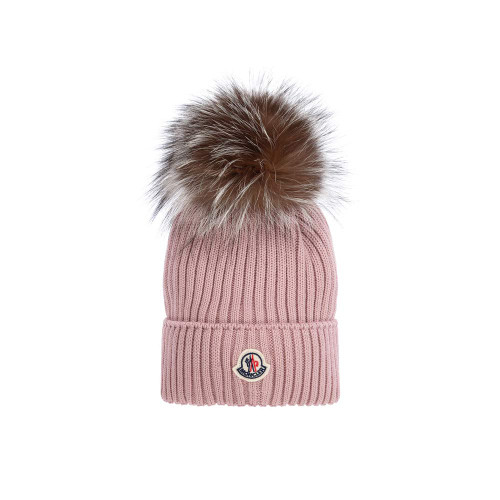 Ribbed pink hat for girls by Moncler Enfant, with a large fur pom-pom. It is made in warm virgin wool and has the brand's fabric logo badge on the brim in ivory, navy blue and red.