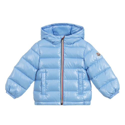 Younger boys pale blue, down filled puffer jacket by luxury brand Moncler. Made in silky smooth polyamide, this water resistant, hooded jacket has elasticated cuffs and the designer's logo patch on one arm.