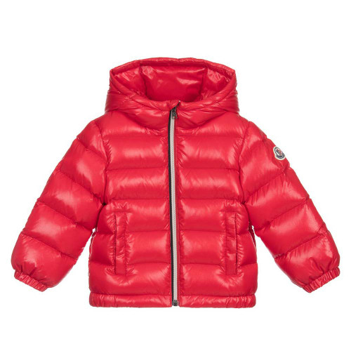 Younger boys red, down filled puffer jacket by luxury brand Moncler. Made in silky smooth polyamide, this water resistant, hooded jacket has elasticated cuffs and the designer's logo patch on one arm.