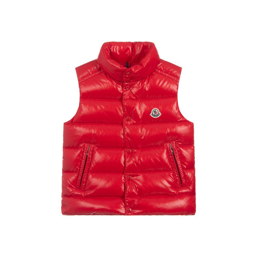 Boys red down padded gilet by luxury brand Moncler Enfant. Soft and silky, this sleeveless lightweight jacket has a zip concealed behind the popper fastening flap.