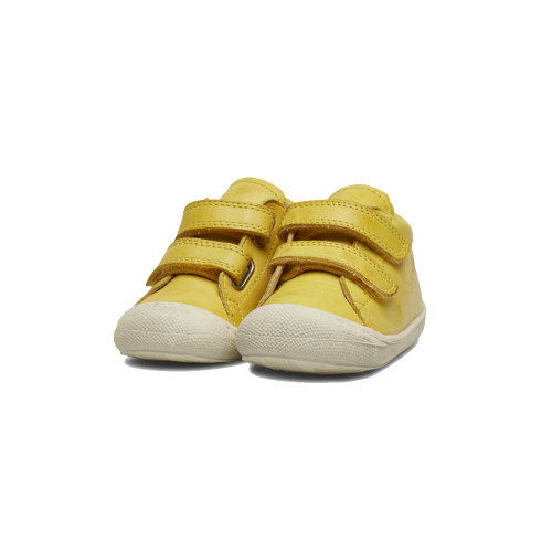 Trendy, yellow shoes for small children comfortably fastened with velcro. Light, leather boots with a higher upper.