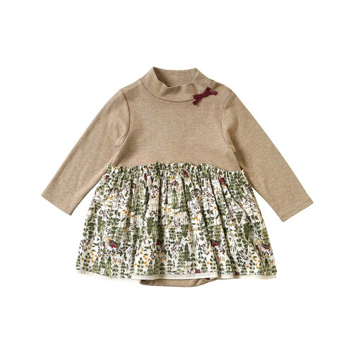A body all that can be coordinated with a flared print skirt with a forest pattern and a mock neck top.
