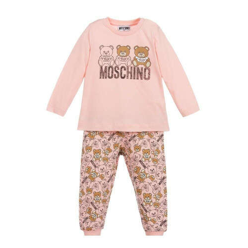 Soft and comfortable for little girls and boys, an ivory outfit set by Moschino Baby, made in cotton jersey. The ivory top has a cute Moschino Teddy Bear and logo print in brown and black, with popper fastenings on one shoulder. The trousers have an all-over Moschino Teddy Bear logo print and ribbed trims.