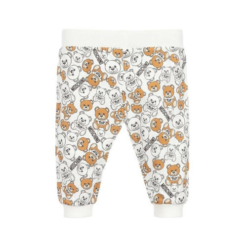 Soft and comfortable for little girls and boys, an ivory outfit set by Moschino Baby, made in cotton jersey. The trousers have an all-over Moschino Teddy Bear logo print and ribbed trims.