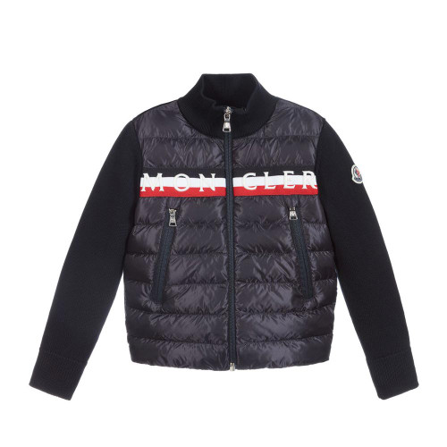 Navy blue zip-up top for boys by luxury French brand Moncler Enfant. Made in a soft cotton knit, it has a down padded puffer style front with zip fastening pockets, and a red, white and navy blue striped trim with a white embroidered logo. The brand's iconic logo patch is on one sleeve.