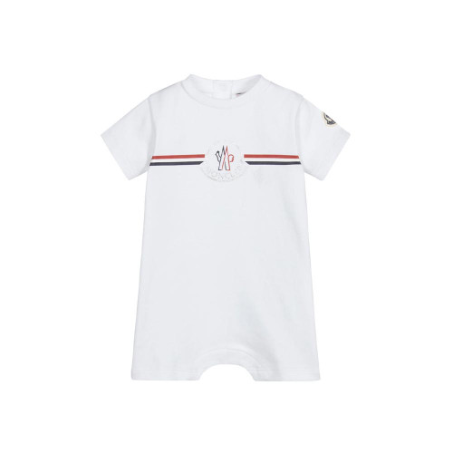 White shortie for baby boys and girls by luxury French brand Moncler Enfant, made in soft and stretchy cotton jersey. It has a red, white, navy blue and silver logo print on the front and the brand's iconic logo patch on one sleeve.