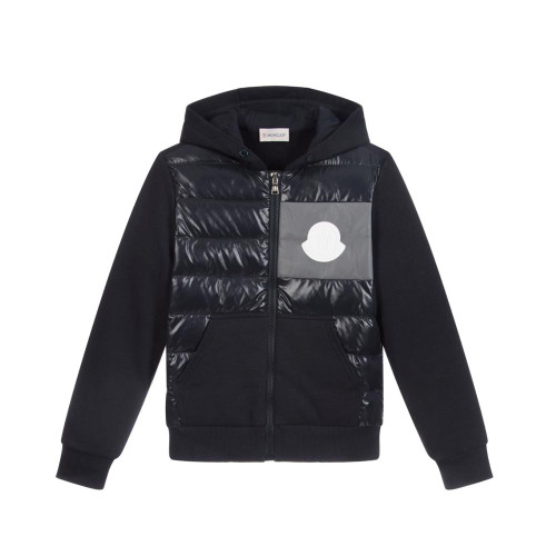 Navy blue hooded zip-up top for teen boys by luxury French brand Moncler Enfant. It is made in soft and stretchy sweatshirt jersey, with a down padded puffer style front. It has jersey patch pockets, branded navy blue rivets on the hood and a white rubber logo patch on the chest.