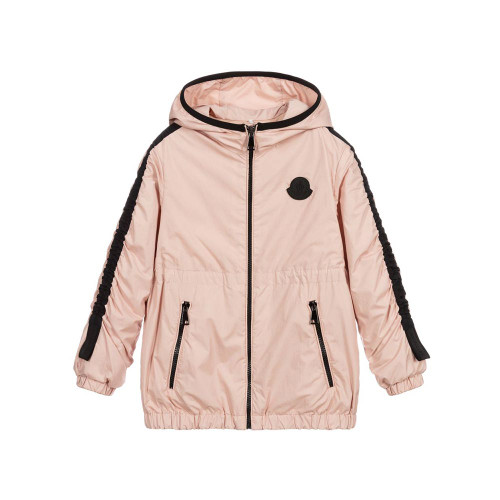 Girls dusky pink windcheater jacket by Moncler Enfant. Silky and lightweight, it has a fixed hood and contrast black piping and trims, with a rubberised logo at the chest. There is a front zip, a toggle adjustable internal waistband and zipped side pockets.