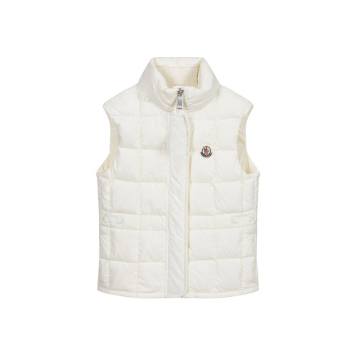 Off-white puffer gilet for girls by luxury French brand Moncler Enfant, made in soft and smooth nylon, with a lightweight down padding. It has a concealed hood in the stand up collar, branded ribbon trims at the side and side seam pockets with poppers. The waist can be adjusted with internal elastics and the brand's iconic logo patch is on the chest.