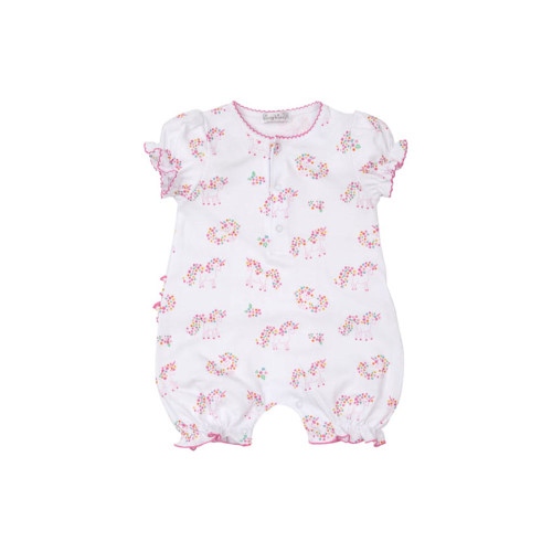 Colorful flowers surround whimsical unicorns on a ruffle-trimmed romper made from supersoft pima cotton.