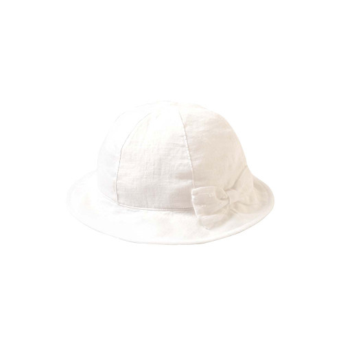 A tulip hat with a large ribbon on a soft gauze fabric.
