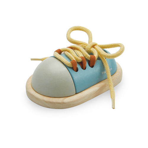 Learning to tie shoes is easy with the Tie-Up Shoe by Plan Toys