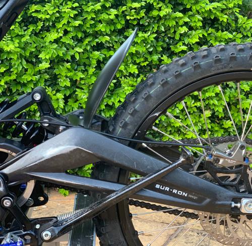 Wider gap helps prevent excessive mud buildup to prevent debris build up between tire