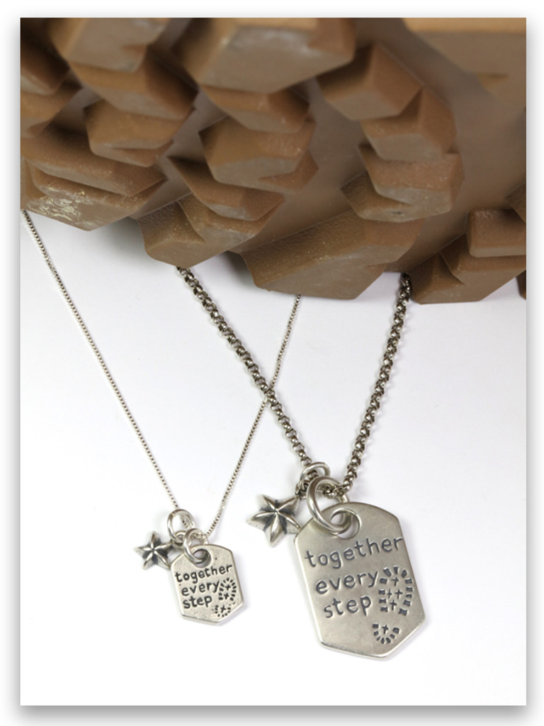 Every Step Pendant and Every Step Charm on Sterling Silver Chains