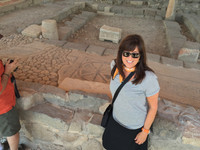 Designer Deborah Harter in front of ancient mosaic floor uncovered in the only synagoue in Galilee. Magdala