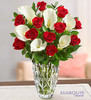 """A dozen classic long-stem red roses and six pristine white Calla lilies are gathered to create one unforgettable bouquet. And paired with our classic Marquis by Waterford crystal vase in the stunning Sparkle pattern €"""" it's a gift that's simply extraordinary."""