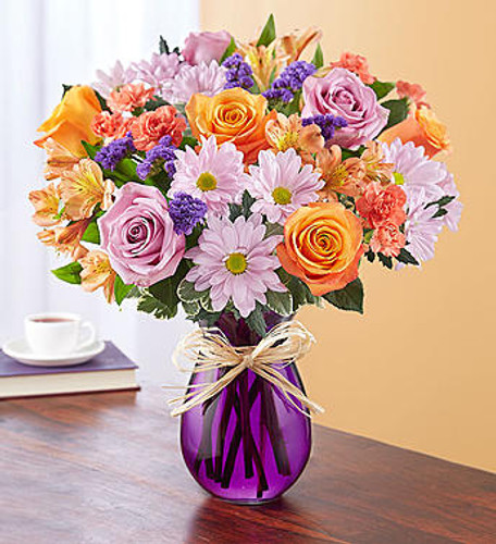 Plum Crazy for Fall EXCLUSIVE For those who live for leaf-peeping season, here's an autumn bouquet they'll be crazy about. Our charming mix of blooms in plums and other autumn hues is handcrafted by our expert florists inside a classic purple vase to highlight the flowers' beauty. A touch of raffia adds a rustic finishing touch.