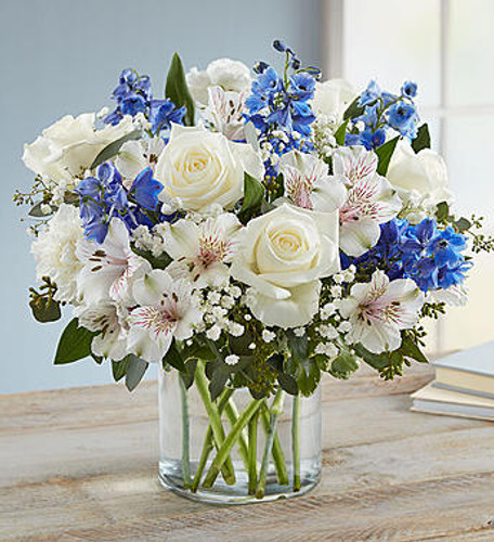Our rustic, easy bouquet in shades of blue and white captures every wish you want to express to those who mean the most. Hand-designed inside a clear cylinder vase, it's a gift that won't leave them wondering how you much you care.