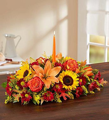 Fields of Europe for Fall Centerpiece The rich beauty of the European countryside comes alive in our best-selling fall centerpiece. Handcrafted by our skilled artisan florists, this vibrant arrangement is filled with a gathering of fresh-picked blooms in brilliant colors. Finished with a glowing orange candle, our signature table display will warm their homes, and their hearts, all throughout the season.