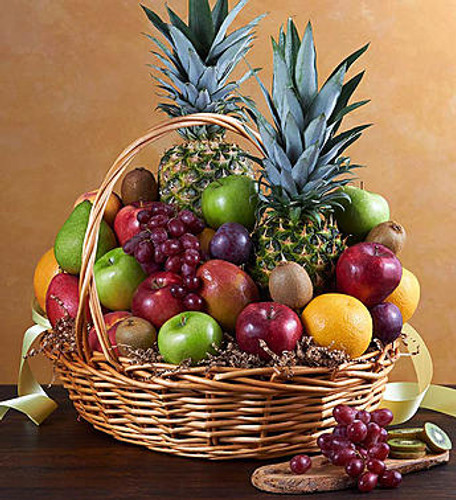 Send your caring wishes and deepest sympathies tastefully to friends or family members with our abundant basket of seasonal orchard-fresh fruit, personally selected by our florists.  **Pineapple not available. Other fruit will be substituted for this.**