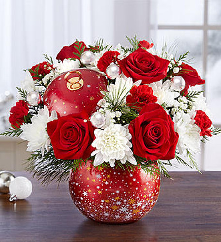 EXCLUSIVE The wonder of a starry night sky comes to life in our new, limited edition holiday arrangement. Joyful red & white blooms are joined by silver ball ornaments, hand-designed inside our keepsake ornament container complete with a matching lid. With its vibrant red finish and display of shimmering stars, this treasured collectible will hold a special place in their heart and home for years to come.