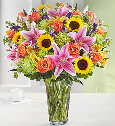 Our new arrangement is sure to make an impression! This surprise is bright, beautiful blooms, hand-arranged inside a classic glass vase. Also available with a bundle of five balloons, it's a special gift to remind family and friends just how much they mean to you.