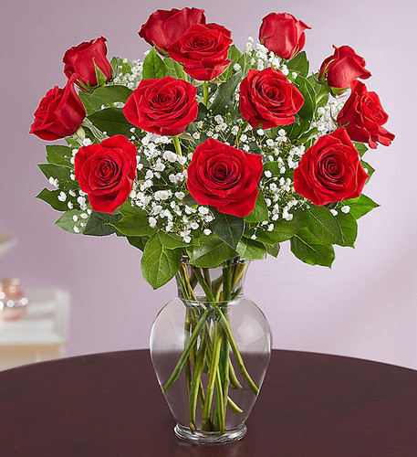 Our premium long stem red roses are an elegant surprise for the one you can trust, the one you can turn to, the one you love with all your heart. Beautifully arranged by our expert florists with lush greenery inside a classic glass vase, 12 or 18 radiant blooms are hand-delivered and ready to delight them for any romantic reason.