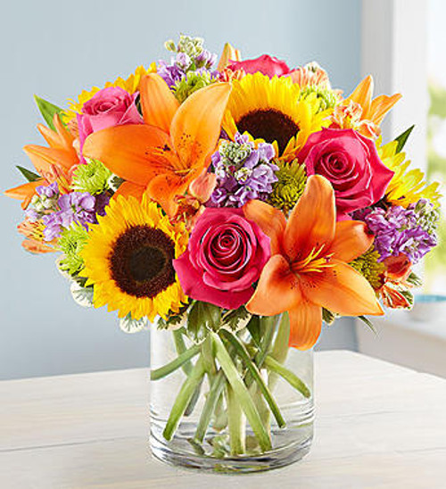 This colorful bouquet is just as special as giving someone a hug in person! Crafted by our expert florists from a vibrant gathering of blooms a classic cylinder vase, its beauty and charm will help you express yourself perfectly, no matter how far apart you are.