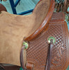 New Stock Saddle by Fort Worth Saddle Co with 15 inch seat. Handsome chestnut colored Jackson saddle with brass accents. Roughout seat and jockeys, drop rig front. Matching billets and flank cinch included. Gullet size is 7.5 inch, weight is 24lbs, and skirt is 26 inch. Made in USA. Limited lifetime warranty.  S996