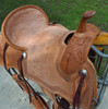 New Cheyenne Stock Saddle by Fort Worth Saddle Co with 15.5 inch seat. Light oil Hermann Oak leather. Roughout contact points and pencil roll seat for secure ride. Gullet size is 7.75 inch, weight is 28lbs, and skirt is 28 inch. Made in USA. Limited lifetime warranty.  S1303