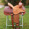 """NEW 13.5"""" PLAYDAY SADDLE Got a young rider who likes play-days and trails, but doesn't want a barrel saddle? This one offers the best of both worlds... the secure deep roughout pencil roll seat and barrel stirrup performance combined with the general appearance of a buckaroo saddle. It can be as serious a saddle as they want, as it's built on a youth sized version of our Mounted Shooter tree.  Pick your own stirrups and conchos. We CAN shorten fenders if needed. Includes latigo, offside, matching leather flank billets and flank cinch, and cinch hobble.  NOT some cheap toy saddle... This is a serial numbered real leather Texas built hand tooled Fort Worth Saddle Co saddle with a US made rawhide over hardwood tree. Your young rider may someday pass it down to their own buckaroo.   Gullet size is 7 inch. Made in USA. Limited lifetime warranty.  S694"""
