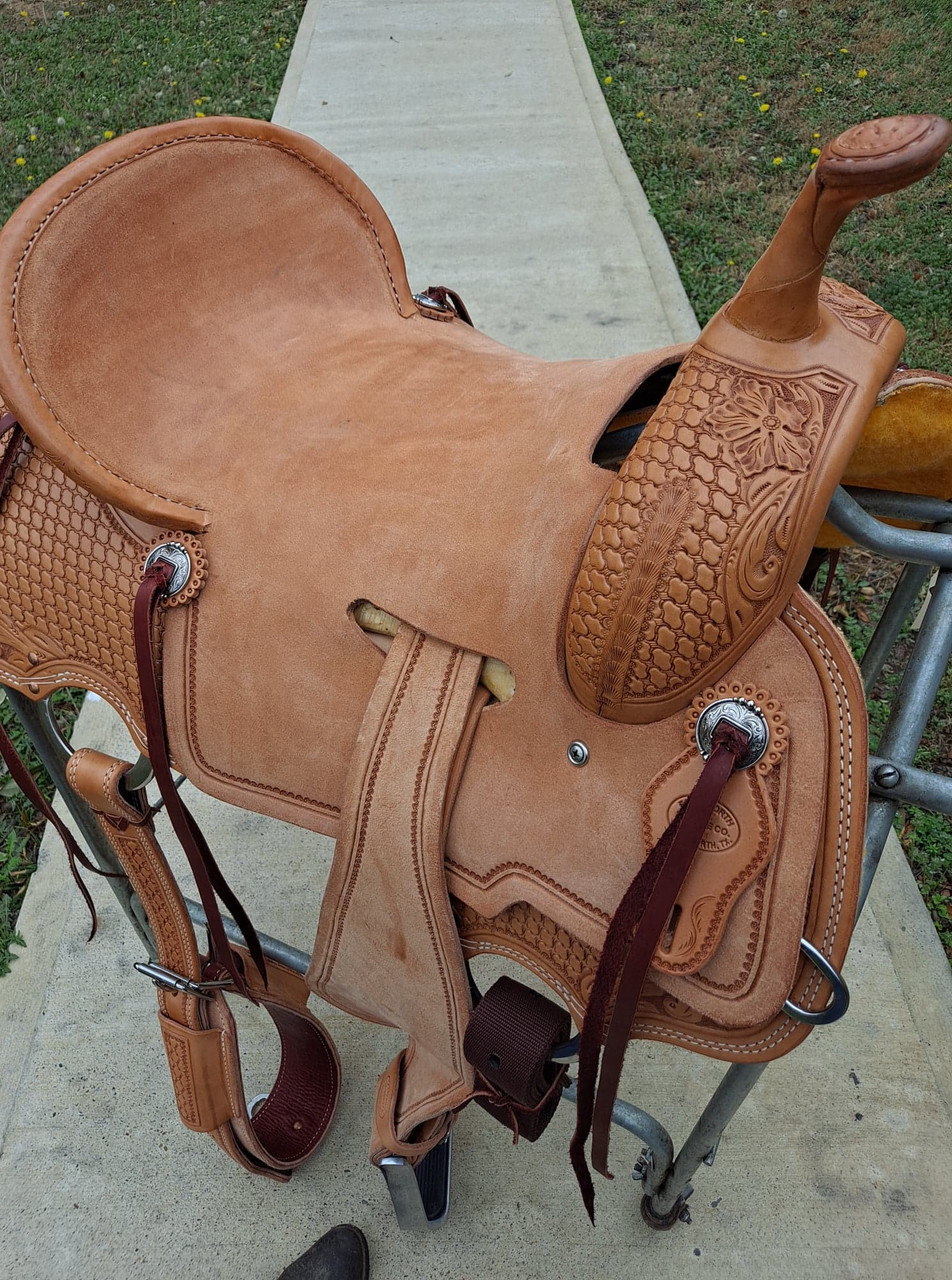 New Cheyenne Stock Saddle by Fort Worth Saddle Co with 16 inch seat. Premium leather in light oil with hand-tooled pommel and skirt. Roughout contact points, and pencil roll seat for maximum security. Skirt rigged fenders for extra stirrup swing. This rig is made for serious competitors. Gullet size is 8 inch, weight is 26lbs, and skirt is 27.5 inch. Made in USA. Limited lifetime warranty.  S1252