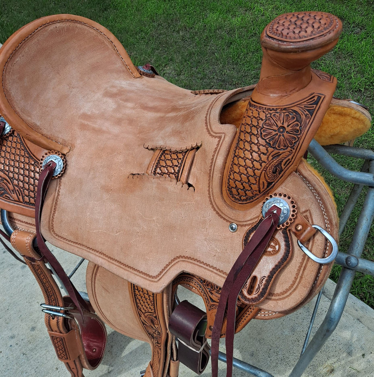 """New Wade Saddle by Fort Worth Saddle Co with 17 inch seat. Hermann Oak leather in light oil antique. 3"""" monel stirrups. Tooled exposed stirrup leathers. Leather latigo and offside. Flank cinch included. Gullet size is 6.75 inch, weight is 38lbs, and skirt is 28.5 inch. Made in USA. Limited lifetime warranty.  S1300"""