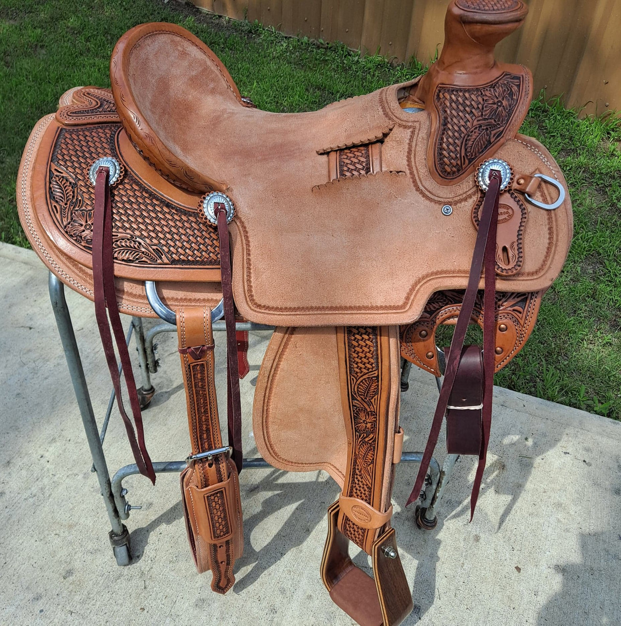 """New Wade Saddle by Fort Worth Saddle Co with 16 inch seat. Hermann Oak leather in light oil antique. 3"""" deep Don Orrell roper walnut stirrups. Tooled exposed stirrup leathers. Leather latigo and offside. Flank cinch included. Gullet size is 7 inch, weight is 38lbs, and skirt is 28.5 inch. Made in USA. Limited lifetime warranty.  S1302"""