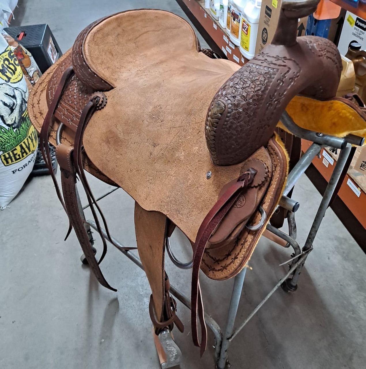 New Ranch Cutter by Fort Worth Saddle Co with 17 inch seat. Well built, hand-tooled ranch cutter. 6 strings, roughout contact points, dark oil finish. Includes latigo and offside, flank billets and flank cinch. Covered by the best warranty in the business. Gullet size is 7 inch, weight is 27lbs, and skirt is 28.75 inch. Made in USA. Limited lifetime warranty.  S1408