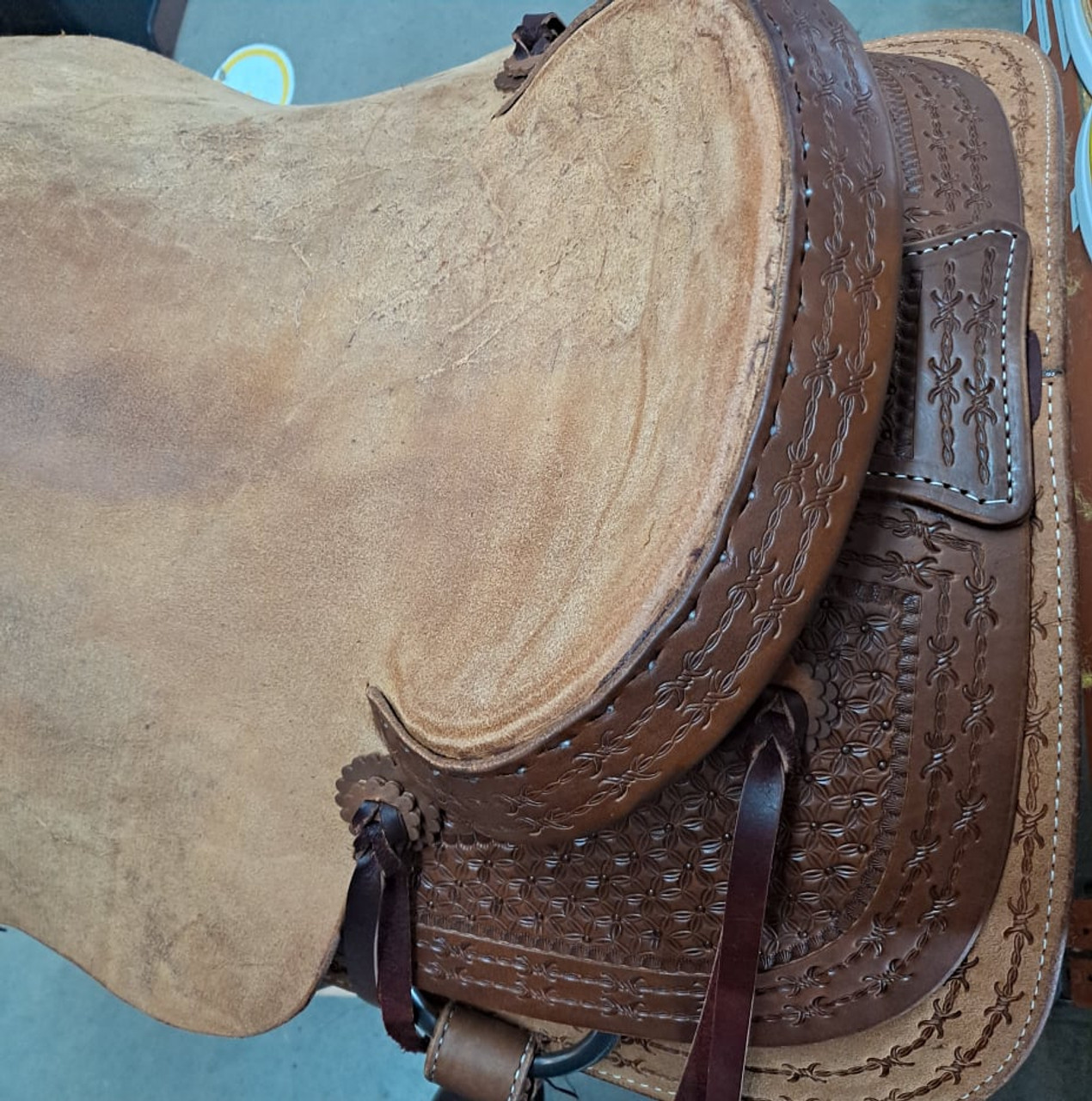 New Ranch Cutter by Fort Worth Saddle Co with 17 inch seat. Well built, hand-tooled ranch cutter. 6 strings, roughout contact points, dark oil finish. Includes latigo and offside, flank billets and flank cinch. Covered by the best warranty in the business. Gullet size is 7.25 inch, weight is 28lbs, and skirt is 28.75 inch. Made in USA. Limited lifetime warranty.  S1409